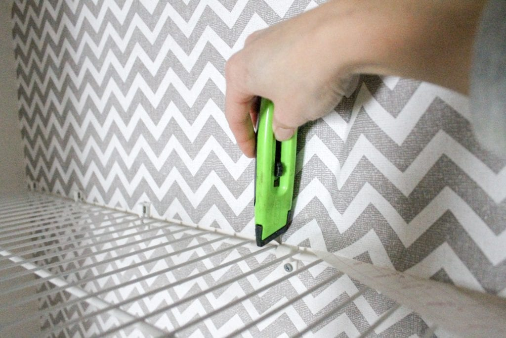 cutting contact paper around shelves