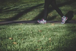picture of a woman's feet and legs walking on a trail