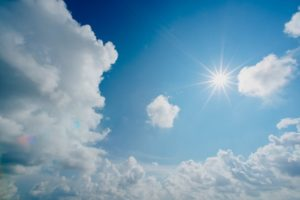 picture of a blue sky with the sun shining