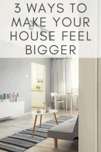 graphic for how to make your house feel bigger picture of a living room with grey and white tones