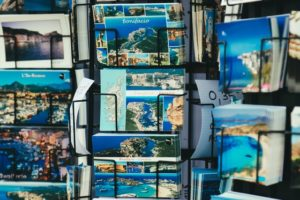 picture of a rack of postcards with beach scenes