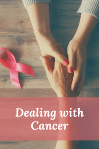 dealing with cancer graphic with picture of women holding hands on a table