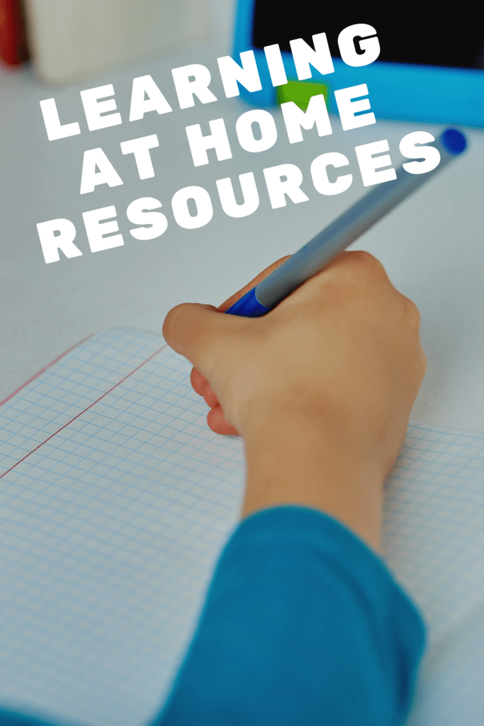 learning at home resources graphic with picture of a young boy's hand writing in a notebook